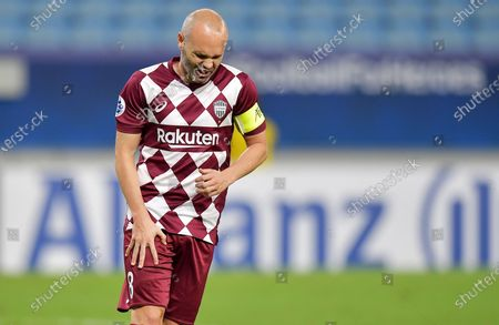 Andres Iniesta of Vissel Kobe holds his thigh after converting his penalty in the penalty shootout during the AFC Champions League quarter final match between Vissel Kobe and Suwon Samsung Bluewings at the Al Janoub Stadium in Al Wakrah, Qatar, 10 December 2020.