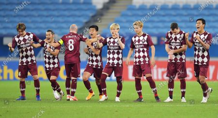 Andres Iniesta of Vissel Kobe turns his back to the goal as his teammates celebrate their opponents missing a penalty in the penalty shootout during the AFC Champions League quarter final match between Vissel Kobe and Suwon Samsung Bluewings at the Al Janoub Stadium in Al Wakrah, Qatar, 10 December 2020.