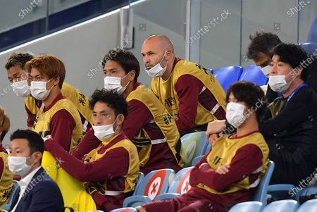 Andres Iniesta (C) of Vissel Kobe and teammates watch from the stands the start of the AFC Champions League quarter final match between Vissel Kobe and Suwon Samsung Bluewings at the Al Janoub Stadium in Al Wakrah, Qatar, 10 December 2020.