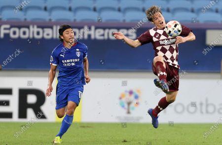 Vissel Kobe's Gotoku Sakai, right, controls the ball past Suwon Samsung Bluewings' Ko Seung-Beom during the Champions League, quarter final, soccer match between Vissel Kobe and Suwon Samsung Bluewings in Doha, Qatar