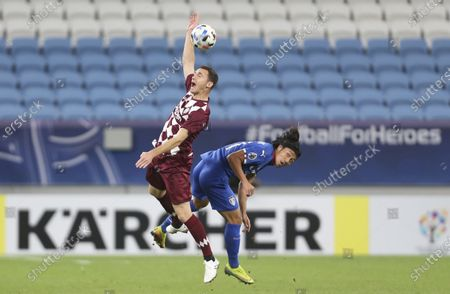 Stock Image of Vissel Kobe's Thomas Vermaelen, left, is challenged by Suwon Samsung Bluewings' Ko Seung-Beom during the Champions League, quarter final, soccer match between Vissel Kobe and Suwon Samsung Bluewings in Doha, Qatar