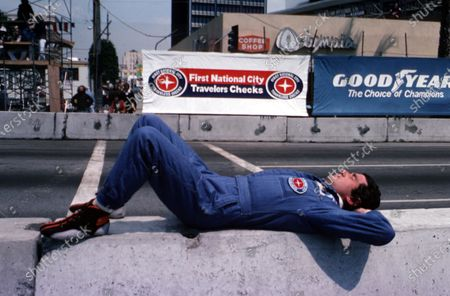 1977 Formula 1 World Championship. Patrick Depailler (Tyrrell-Ford Cosworth) asleep on the pit wall. Ref-D2A 05. World - LAT Photographic