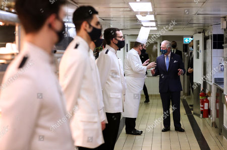 Prince Charles speaks to Executive Chef John Williams during a visit to The Ritz London, in support of the hospitality sector.