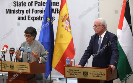 Spanish Foreign Minister Arancha Gonzalez Laya (L) and Palestinian Foreign Minister Riyad Al-Maliki (R) give a joint press conference in the West Bank city of Ramallah, 10 December 2020. Laya earlier in the day met with President Mahmoud Abbas and reiterated that her country supports peace between Palestinians and Israel based on the two-state solution and international law.