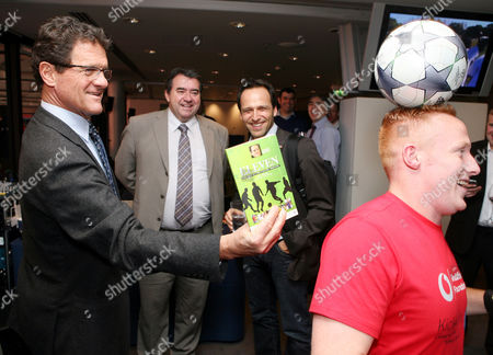 Fabio Capello promoting the new book 'Eleven' by Steve Fleming, as watched by football  radio and tv commentator Jonathan Pearce (2nd l)