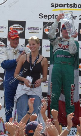 2003 Champ Car Series 26-28 Sept 2003 Grand Prix of Americas Miami, Florida. priority Super Model, Nikki Taylor presents Dominguez his first place trophy. 2003-Dan R. Boyd USA LAT Photographic