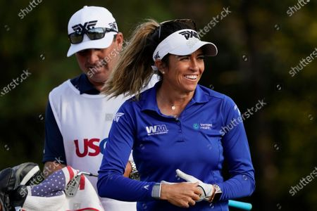 Gerina Piller smiles after her shot from the 16th tee, during the first round of the U.S. Women's Open Golf tournament, in Houston