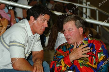 Actor Sylvester Stallone chats with William Shatner as they attend the 14th Annual Wells Fargo Hollywood Charity Horse Show at the Los Angeles Equestrian Center in Burbank, Ca