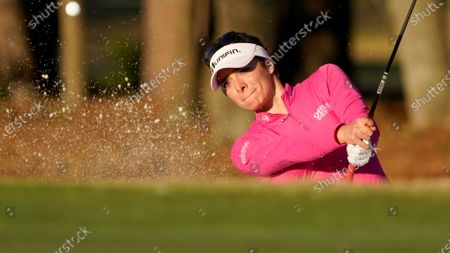Gaby Lopez, of Mexico hits out of a bunker during the first round of the U.S. Women's Open golf tournament in Houston