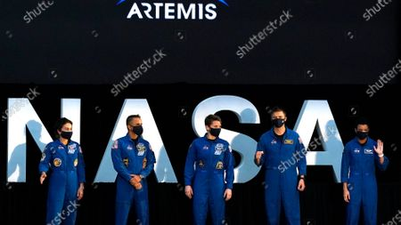 Stock Photo of Five of the astronauts that will be part of the Atremis missions, from left, Jessica Meir, Joe Acaba, Anne McClain, Matthew Dominick, and Jessica Watkins are introduced by Vice President Mike Pence during the eighth meeting of the National Space Council at the Kennedy Space Center, in Cape Canaveral, Fla