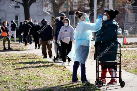 Registered nurse Laura Moore, left, swabs a patient during testing for COVID-19 organized by Philadelphia FIGHT Community Health Centers at Mifflin Square Park, in south Philadelphia
