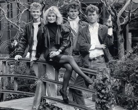 Editorial photo of A-ha Pop Group. Band Members Morten Mags And Pal Pictured With Bond Girl Karen Seeburg. A-ha Have Recorded The New Bond Theme For The James Bond Film The Living Daylights.