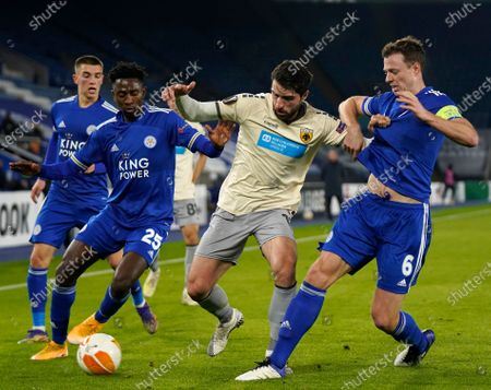 Karim Ansarifard (C) of AEK Athens in action against Leicester players Wilfred Ndidi (L) and Jonny Evans (R) during the UEFA Europa League group G soccer match between Leicester City and AEK Athens in Leicester, Britain, 10 December 2020.