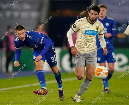 Leicester's Luke Thomas (L) in action against Karim Ansarifard (R) of AEK Athens during the UEFA Europa League group G soccer match between Leicester City and AEK Athens in Leicester, Britain, 10 December 2020.