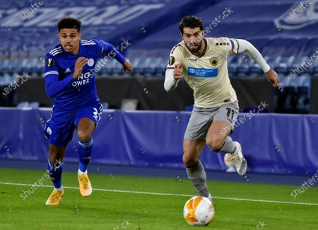 AEK's Karim Ansarifard, right, and Leicester's James Justin run for the ball during the Europa League Group G soccer match between Leicester City and AEK Athens at the King Power Stadium in Leicester, England