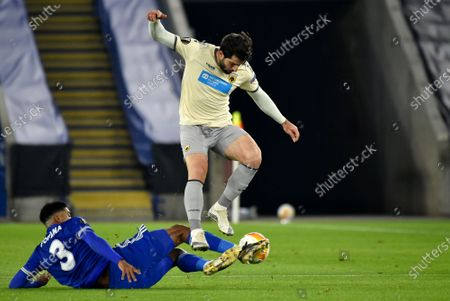 AEK's Karim Ansarifard, right, duels for the ball with Leicester's Wesley Fofana during the Europa League Group G soccer match between Leicester City and AEK Athens at the King Power Stadium in Leicester, England