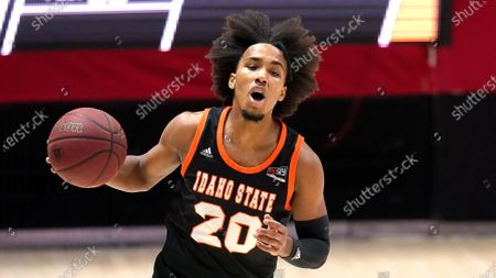 Idaho State guard Robert Ford III (20) brings the ball up court during the first half of an NCAA college basketball game against Utah, in Salt Lake City