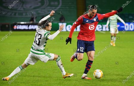 Diego Laxalt (L) of Celtic in action against Yusuf Yazici of Lille during the UEFA Europa League group H soccer match between Celtic Glasgow vs OSC Lille in Glasgow, Britain, 10 December 2020.