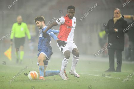 Feyenoord's Luis Sinisterra center right, and Wolfsberger's Michael Novak challenge for the ball during the UEFA Europa League Group K soccer match between Wolfsberger AC and Feyenoord at the Woerthersee Stadium in Klagenfurt, Austria, . Right are Feyenoord's head coach Dick Advocaat