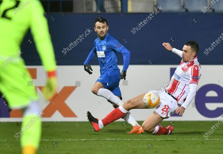 Milan Rodic (R) of Red Star in action against Jakub Pesek  (C) of Liberec during the UEFA Europa League group L soccer match between Slovan Liberec and Red Star Belgrade in Liberec, Czech Republic, 10 December 2020.