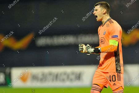 Dinamo Zagreb's goalkeeper Dominik Livakovic celebrates after Dinamo Zagreb's Josko Gvardiol scored his side's opening goal during the group K Europa League soccer match between Dinamo Zagreb and CSK Moscow at the Maksimir stadium in Zagreb, Croatia