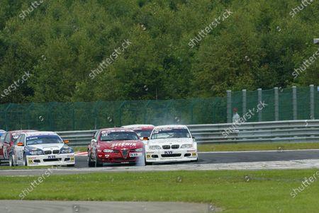 2004 European Touring Car Championship (ETCC) Spa-Francorchamps, Belgium. 31st July 2004.  Jorg Muller (BMW Team Deutschland BMW 320i) outbrakes Gabrielle Tarquini (Alfa Romeo Team Autodelta 156Gta). Action.  World Copyright: John Brooks/LAT Photographic