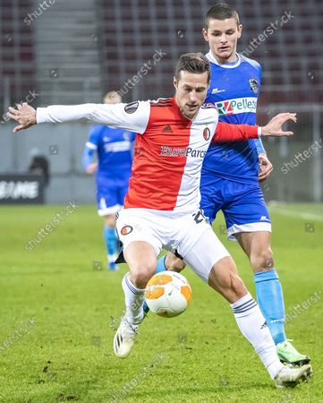Uros Spajic (L) of Feyenoord and Dejan Joveljic of Wolfsberger AC in action during the UEFA Europa League group K soccer match between RZ Pellets Wolfsberg and Feyenoord Rotterdam at the Woerthersee stadium in Carinthia, Austria, 10 December 2020.