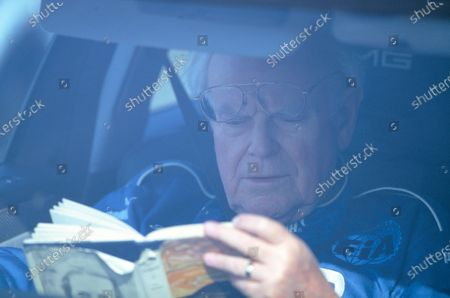 2004 San Marino Grand Prix. Imola, Italy 23rd - 25th April 2004 Professor Sid Watkins sits in the pace car reading a book.  World Copyright:Michael Cooper/LAT Photographic /LAT Photographic Ref: 35mm Image A44