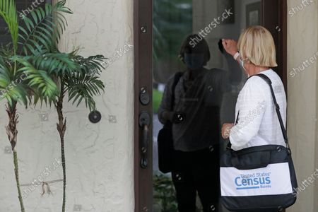 Stock Picture of A census taker knocks on the door of a residence in Winter Park, Fla. The congressional committee that oversees the Census Bureau issued a subpoena, to U.S. Commerce Secretary Wilbur Ross for documents related to data irregularities that are putting in jeopardy a year-end deadline for turning in numbers used for divvying up congressional seats. Democrat U.S. Rep. Carolyn Maloney is the chair of the House Committee on Oversight and Reform