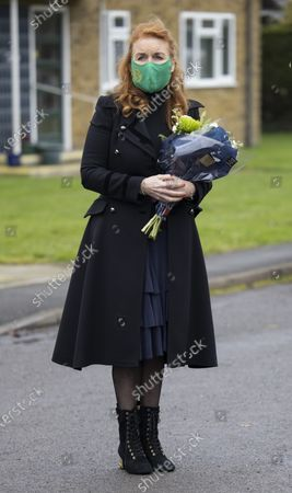 Sarah Ferguson Duchess of York meets Crown Estates workers and local bin men as she hands out Christmas cheer in Old Windsor.
