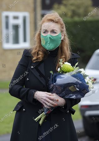 Stock Image of Sarah Ferguson Duchess of York meets Crown Estates workers and local bin men as she hands out Christmas cheer in Old Windsor.