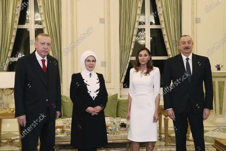 Stock Photo of Turkey's President Recep Tayyip Erdogan, left, and his wife Emine, pose for photographs with Azerbaijan's President Ilham Aliyev, right, and Vice President Mehriban Alieva, who is also Aliev's wife, following their meeting in Baku, Azerbaijan, . A massive military parade was held in celebration of the peace deal with Armenia over Nagorno-Karabakh that saw Azerbaijan reclaim much of the separatist region along with surrounding areas. Erdogan attended as Turkey strongly backed Azerbaijan during the conflict, which it used to expand its clout in the region