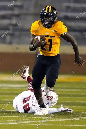 Southern Mississippi running back Frank Gore Jr. (21) runs past Florida Atlantic linebacker Eddie Williams (58) on his way to a 73-yard touchdown run during the first half of an NCAA college football game, in Hattiesburg, Miss