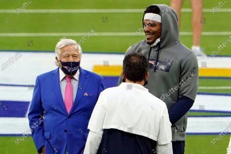 New England Patriots owner Robert Kraft, left, stands next to quarterback Cam Newton before an NFL football game against the Los Angeles Rams, in Inglewood, Calif