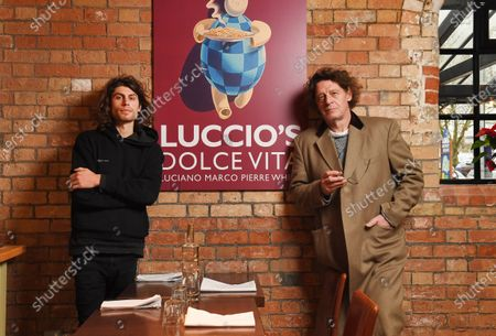 Stock Image of Marco Pierre White and son Luciano Pierre White at the new restaurant in Dorchester.  Marco Pierre White's son has opened his first restaurant as he follows in the famous chef's footsteps.  Luciano Pierre White, 26, and his three time Michelin star winning father both attended the launch of Luccio's in Dorchester, Dorset.  Luciano has designed the menu for the Italian eatery and will also lead a team of chefs there.  He has been in the kitchen with Marco from a young age and gained experience cooking at restaurants in France and Spain under the tutelage of celebrated chefs Pierre Koffmann and Ferran Adria.