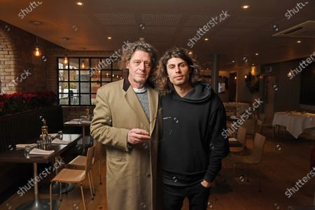 Stock Picture of Marco Pierre White and son Luciano Pierre White at the new restaurant in Dorchester.  Marco Pierre White's son has opened his first restaurant as he follows in the famous chef's footsteps.  Luciano Pierre White, 26, and his three time Michelin star winning father both attended the launch of Luccio's in Dorchester, Dorset.  Luciano has designed the menu for the Italian eatery and will also lead a team of chefs there.  He has been in the kitchen with Marco from a young age and gained experience cooking at restaurants in France and Spain under the tutelage of celebrated chefs Pierre Koffmann and Ferran Adria.