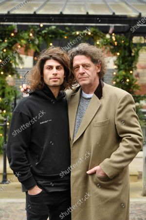 Stock Photo of Marco Pierre White and son Luciano Pierre White at the new restaurant in Dorchester.  Marco Pierre White's son has opened his first restaurant as he follows in the famous chef's footsteps.  Luciano Pierre White, 26, and his three time Michelin star winning father both attended the launch of Luccio's in Dorchester, Dorset.  Luciano has designed the menu for the Italian eatery and will also lead a team of chefs there.  He has been in the kitchen with Marco from a young age and gained experience cooking at restaurants in France and Spain under the tutelage of celebrated chefs Pierre Koffmann and Ferran Adria.