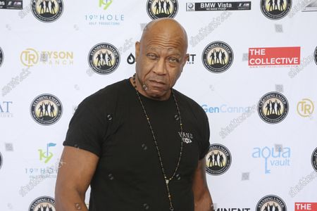 """Stock Photo of Tommy 'Tiny' Lister attends the Mike Tyson Standing United and the Tyson Ranch Celebrity Golf Tournament in Dana Point, Calif. Tommy """"Tiny"""" Lister, a former wrestler who was known for his Deebo character in the """"Friday"""" films, has died. He was 62. Lister manager, Cindy Cowan, said Lister was found unconscious in his home in Marina Del Rey, California, on Thursday, Dec. 10, 2020. He was pronounced dead at the scene"""