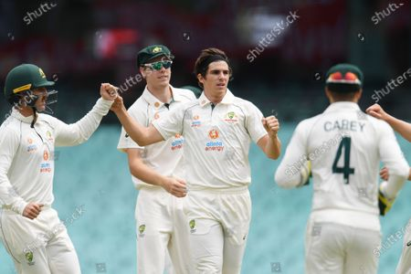 Sean Abbott of Australia (C) celebrates taking the wicket of Mayank Agarwal of India during a tour match between Australia A and India at the SCG in Sydney, Australia, 11 December 2020.