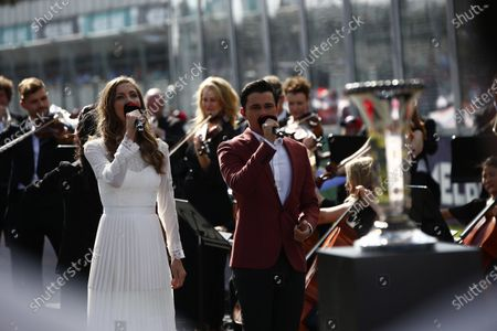 Samantha Jade sings the Australian national anthem on the grid.