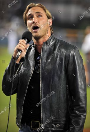 "Actor Kyle Lowder, of the soap opera ""The Bold and the Beautiful sang the National Anthem before Los Angeles Dodgers took on the San Diego Padres at Dodgers Stadium in Los Angeles. """