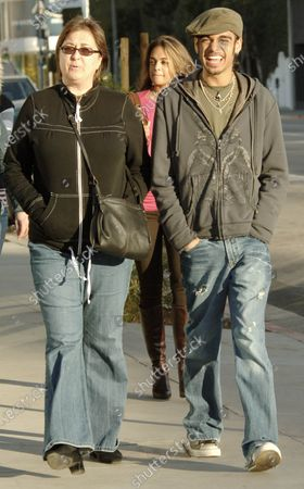Sanjaya Malakar former American Idol contestant who was more popular for his wild hair styles then his fair singing abilities strolls along Melrose Avenue in West Hollywood, ca with his family