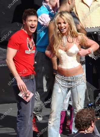 """Britney Spears performs her new song """"Toxic"""" in front of hundreds of screaming fans  live on the Ryan Seacrest show in Hollywood, Ca .  The singer who starts her US concert tour in San Diego, Ca in March was the sole guest on the show and finished the hour by performing the one song after which Ryan Seacrest announced that in addition to being the host of """"American Idol"""" and his own chat show he would be taking over the morning radio duties from legendary DJ Rick Dees. <B>"""