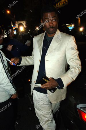 Chris Rock chats with Ingrid Casares who is a good friend of Madonna as they head to their cars after leaving Hyde Nightclub in West Hollywood, Ca