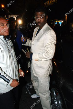 Editorial image of Chris Rock chats with Ingrid Caseras as they leave Hyde in West Hollywood, Ca, California, USA - 03 Dec 2006