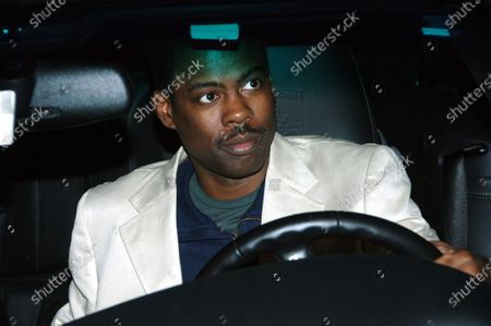 Stock Photo of Chris Rock chats with Ingrid Casares who is a good friend of Madonna as they head to their cars after leaving Hyde Nightclub in West Hollywood, Ca