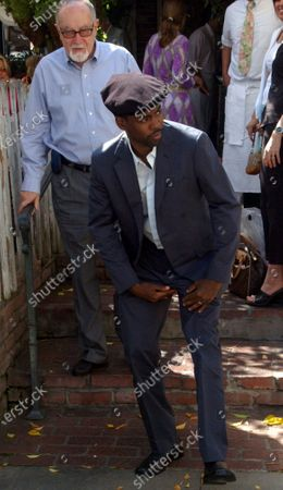 Chris Rock  stops to adjusts the crotch of his pants on the way out of the trendy  Ivy restaurant and then shakes hands with Oscar producer Gilbert Cates immediatley afterwards lets hope Cates  went directly home and washed his hands