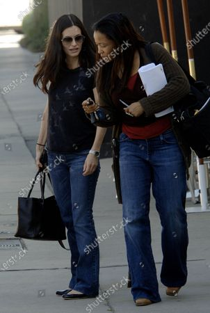 Courtney Cox who plays a tabloid editor on the hit television show Dirt gets the tables turned as she facees a sea of Paparazzi as she heads to her car after having lunch at Melrose Restaurant in West Hollywood, Ca