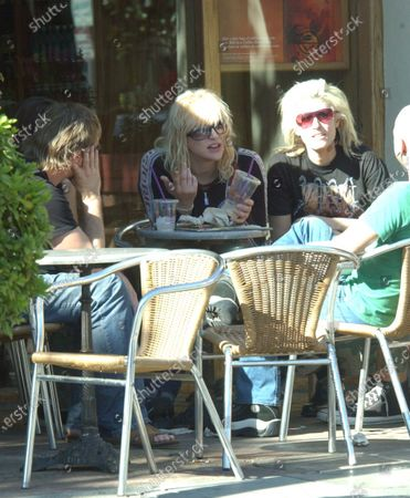 Courtney Love spends the afternoon hanging out at the Coffee Bean along Sunset Boulevard with a group of friends The singer who is due in court this week spent over 1 hour at the Coffee shop before then heading into Tracy Ross a popular clothing store where she changed clothes and then headed off to her hotel whilst walking arm in arm with a female friend who she seemed to be paying a lot of attention to