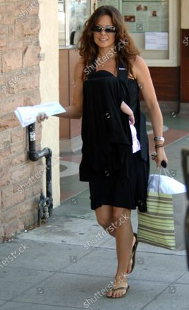 Exclusive - Brooke Burke the popular actress/model and former host of E Wild On Travel series spends the morning shopping and running errands with infant daughter Heaven Rain Charvet in Santa Monica, Ca Brooke 1st had breakfast at the Blue Plate restaurant with fiance David Charvet and then went to Baby Style where she picked up some baby clothes and then posted some letters and then headed back to her car